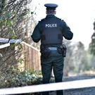 Police at the crime scene at Lake Road in Craigavon