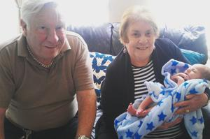 Isobel and Arty Vallely with grandson Noah