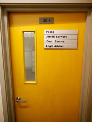 Signs on doors marking the different type of services inside the nuclear bunker