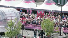 Thousands of cycling fans line the streets of Armagh to cheer on the riders