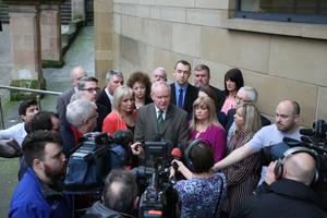 Sinn Fein MLA Martin McGuinness speaks to the press at the Millennium Forum in Londonderry on Saturday after announcing he was seeking election as an MLA for Foyle, his home constituency. He is currently an MLA for Mid-Ulster