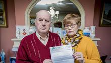 Stephen and Breege Quinn with the letter from Sinn Fein's Conor Murphy