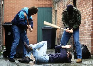 Paramilitaries use punishment beatings to maintain their control (picture posed)