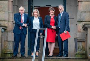 Former NI Secretary of State Julian Smith with PM Boris Johnson, Deputy First Minister Michelle O'Neill and First Minister Arlene Foster on the steps of Stormont earlier this year