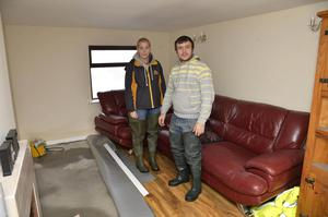 Adrian McKernan and Megan Rafferty inside their flooded home