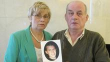 Stephen and Breege Quinn holding a photo of their murdered son Paul