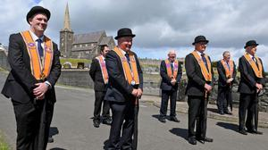 A small group of Orangemen (social distancing) gathered at the bridge on Drumcree Hill yesterday to mark the 25th Anniversary of the Drumcree Protest. Photo: Justin Kernoghan