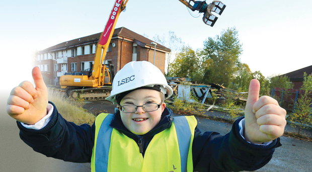 Conor Canning, a year eight pupil at Arvalee School and Resource Centre, gives the thumbs-up to the start of demolition at the former Army base at Lisanelly in Omagh,