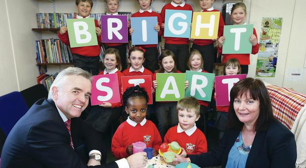Junior ministers Jennifer McCann and Jonathan Bell with children from Carryduff Playcare Group at the launch of the Bright Start school age childcare grant scheme