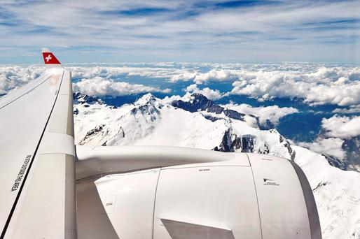 Bombardier's new CSeries plane takes its first passenger flight over the Swiss Alps yesterday