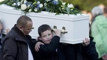 Tragic Adam's brother Cameron carries his coffin in Cloughmills, Co Antrim yesterday