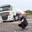 Kieran McCauley with one of the lorries he drives
