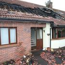 The damage caused to Joe's house