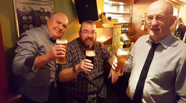 Pals James Privilege, Anthony Burke and Billy McGookin have a final drink