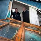 Andrew Upton and Barry Kelly from the National Trust standing inside a hut at Mount Stewart destroyed by a falling tree