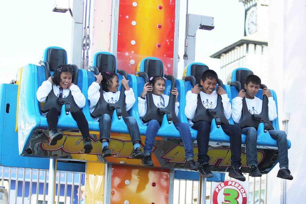 The orphans on one of the rides at Barry's Amusements