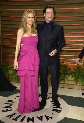 John Travolta, pictured with his wife Kelly
