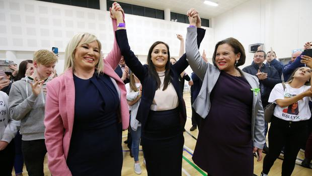 Orfhlaith Begley with party leaders Michelle O'Neill (left) and Mary-Lou McDonald at the count centre in Omagh Leisure Centre in Co Tyrone