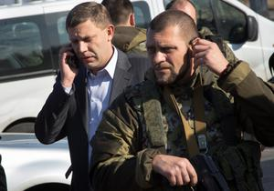 Pro-Russian rebel leader Alexander Zakharchenko (left) flanked by security at Donetsk airport