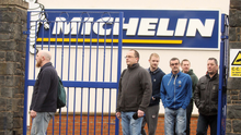 Workers leave the Michelin plant after hearing that it will be closed in the next two years