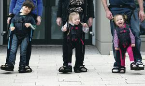 Daniel Smyth (5), Bethany Watson (3) and Charlotte Taylor (3) using the Upsee. Pic William Cherry