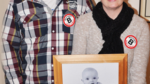 Emma and Darren Coweyhold a photograph of their son Jamie