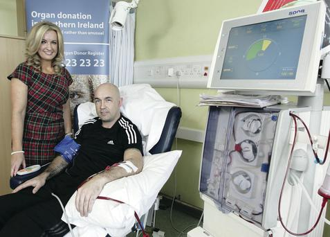 The proposer of the original organ donor Bill, Jo-Anne Dobson, with dialysis patient Justin Weir at Daisy Hill Hospital, Newry