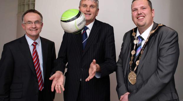 Health Minister Jim Wells (centre) yesterday with Professor Frank Kee (left), director of the Centre of Excellence for Public Health at Queen's University, and Lisburn Mayor Andrew Ewing