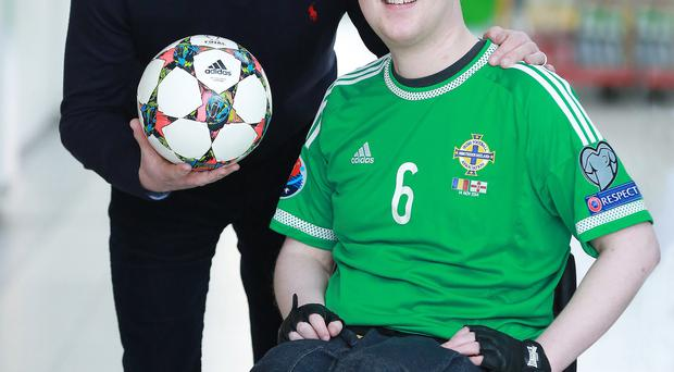Transplant patient Ryan O'Connor with Northern Ireland boss Michael O'Neill