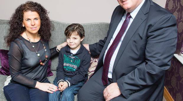 Upper Bann MP David Simpson with Oliver and his mother