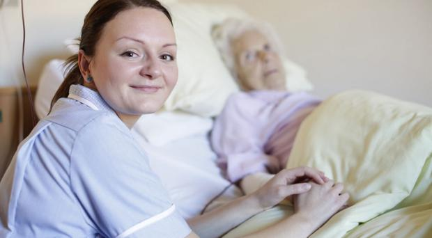 A nurse with her patient. Picture posed