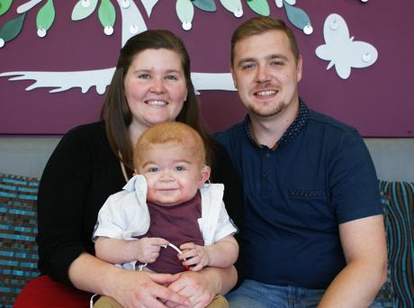 Mark McKnight and Eva Johnson with their son Leo