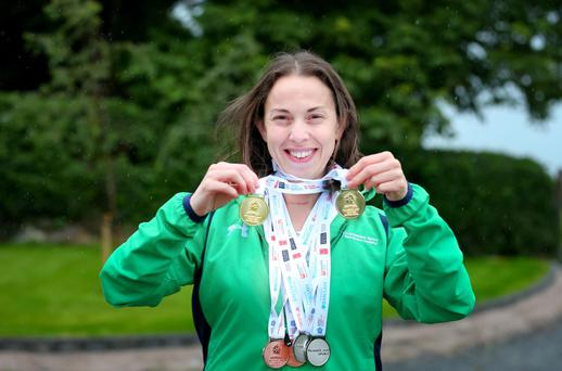 Kathryn Glover at her home with her six medals