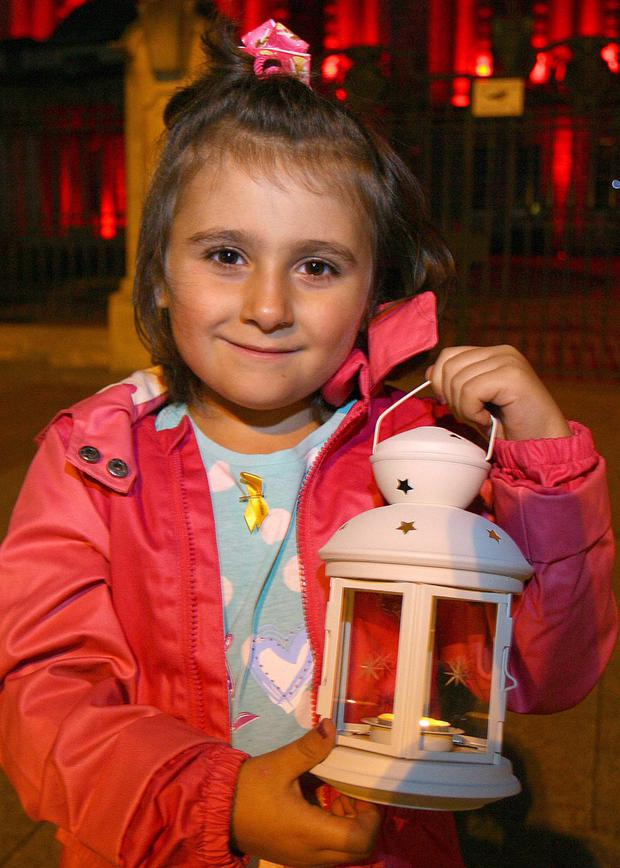 Six-year-old Alara Basturk from Belfast, who is battling leukaemia, shines a light during Childhood Cancer Awareness Month