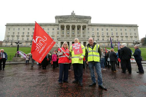 Members of Unite protest at Stormont against cuts