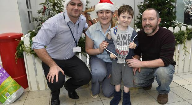 Surgeons David Colvin and Chantelle McMullan with George Clenaghan and dad James