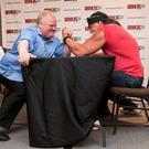 Rob Ford and Hulk Hogan arm wrestling