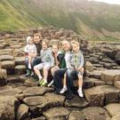 The Mulholland family (from left) Maire, mum Cathy, Malachy, Meabh, dad Mark and Conleth enjoy day out at the Giant's Causeway