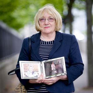 Nuala Mulholland with a picture of her mum Rosaline McEneaney