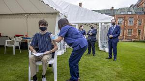 Tiernan Feeney, 19, a first year Computer Science student at Queen's University Belfast receives the first dose of the COVID-19 vaccination during a campus vaccine initiative at the University launched by Northern Ireland Minister of Health Robin Swann (Liam McBurney/PA)