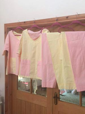 The scrubs made from the sheets donated by woman named Evelyn