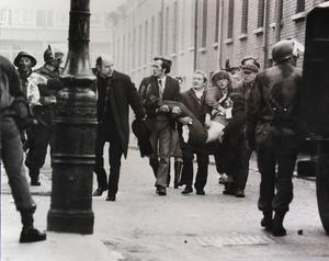 A casualty is carried away on Bloody Sunday