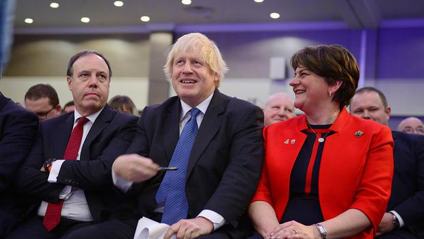 Nigel Dodds and Arlene Foster with Boris Johnson at the 2018 DUP conference
