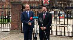 Micheal Martin and Colum Eastwood at Queen's University yesterday