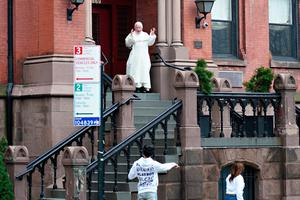 New York: A member of the clergy at St Vincent Ferrer greets local residents