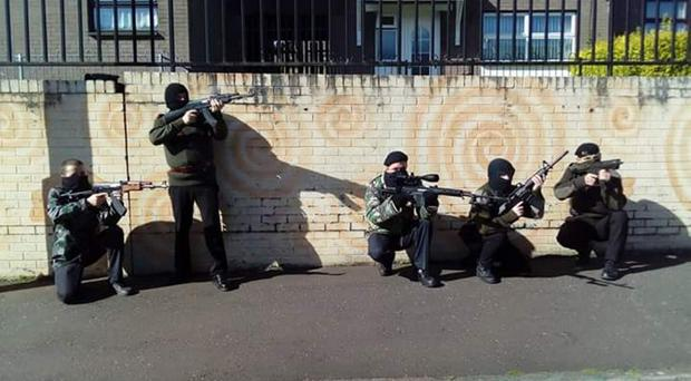 A historical enactment, with participants dressed up as terrorists, has been criticised by the DUP's Gregory Campbell