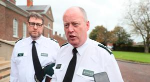 George Hamilton speaks to the media yesterday, accompanied by Assistant Chief Constable Stephen Martin