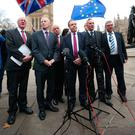 Nigel Dodds and fellow DUP MPs (from left) Jim Shannon, Gregory Campbell, David Simpson, Emma Pengelly, Gavin Robinson, Ian Paisley and Sammy Wilson speak to the media outside Westminster yesterday
