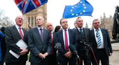 Nigel Dodds and fellow DUP MPs (from left) Jim Shannon, Gregory Campbell, David Simpson, Emma Pengelly, Gavin Robinson, Ian Paisley and Sammy Wilson speak to the media outside Westminster.