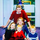 The Magees at home with Thomas (centre) and their daughters before the tragic accident